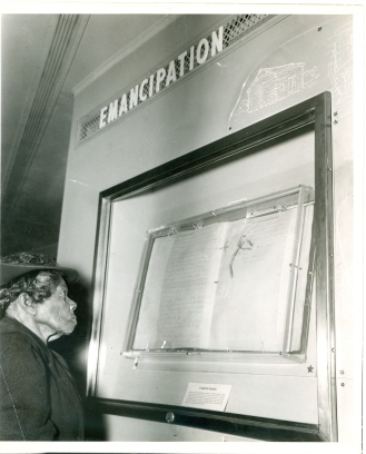 Sally Fickland, a former slave, views the Emancipation Proclamation in Philadelphia in 1947.
