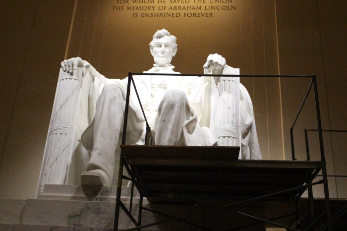 The Lincoln Memorial undergoing cleaning to remove green paint.