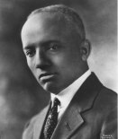 Portrait of a young Woodson, circa 1925. (Photo: Scurlock Studio Records, ca. 1905-1994, Archives Center, National Museum of American History)
