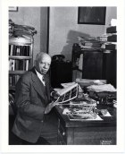 Woodson at work in his study, circa 1940s. (Photo: Scurlock Studio Records, ca. 1905-1994, Archives Center, National Museum of American History)