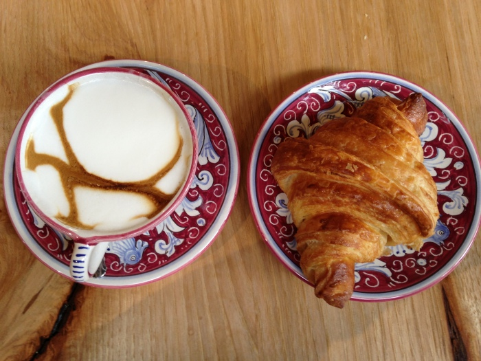 A cappuccino and croissant at La Colombe.