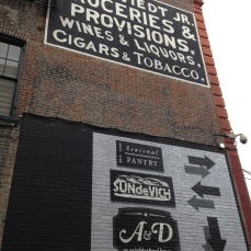 Signage both old and new for the businesses of Blagden Alley.