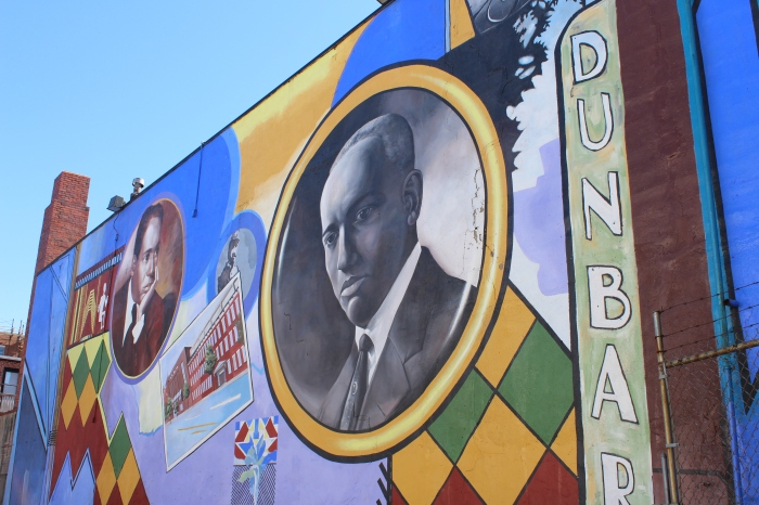 Mural on Ninth Street depicting Carter G. Woodson and other Shaw landmarks.